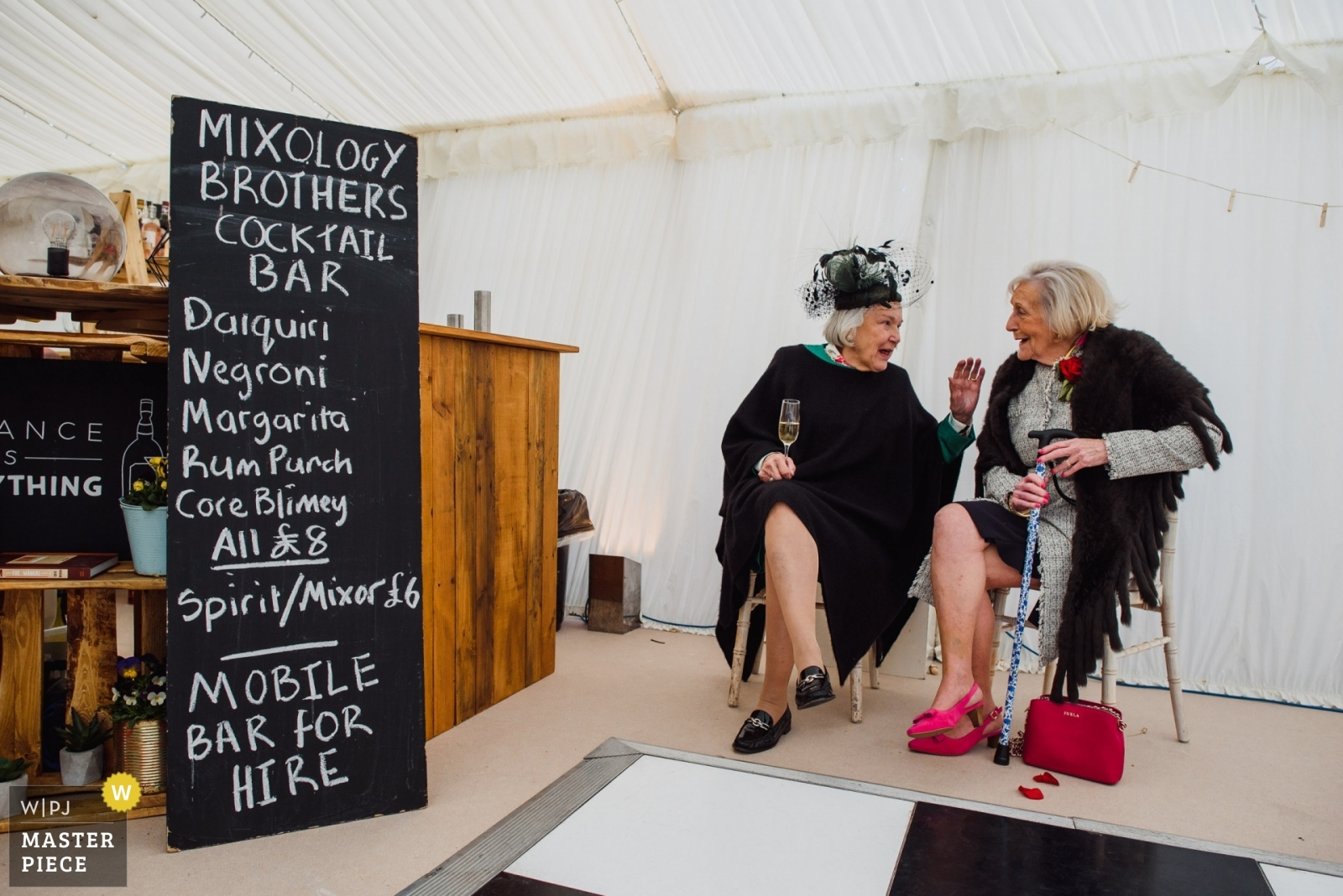 Two older women having a dring - West Midlands, England Wedding Photography -  | Private farm near Ely, UK