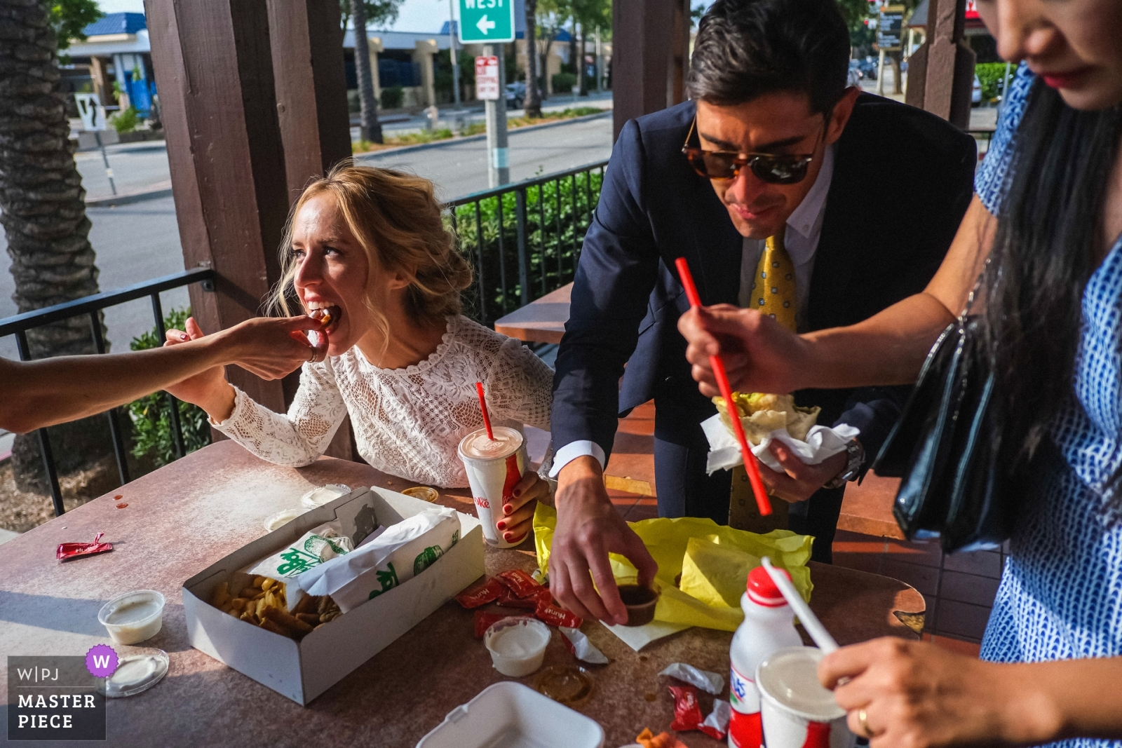 The bride and groom eat fast food with their friends and family after their church ceremony - San Diego, California - Southern Wedding Photography -  | Pasadena, CA, St. Andrew Catholic Church