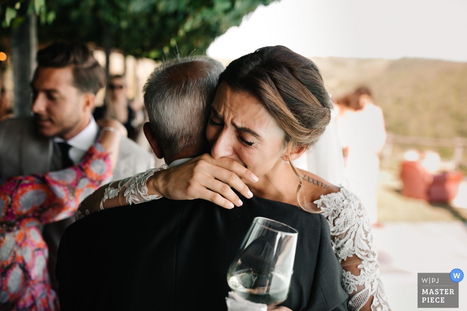 Bride hugging her dad with tears - Portofino, Genoa Wedding Photography -  | Conti di San Bonifacio Wine Resort, Tuscany