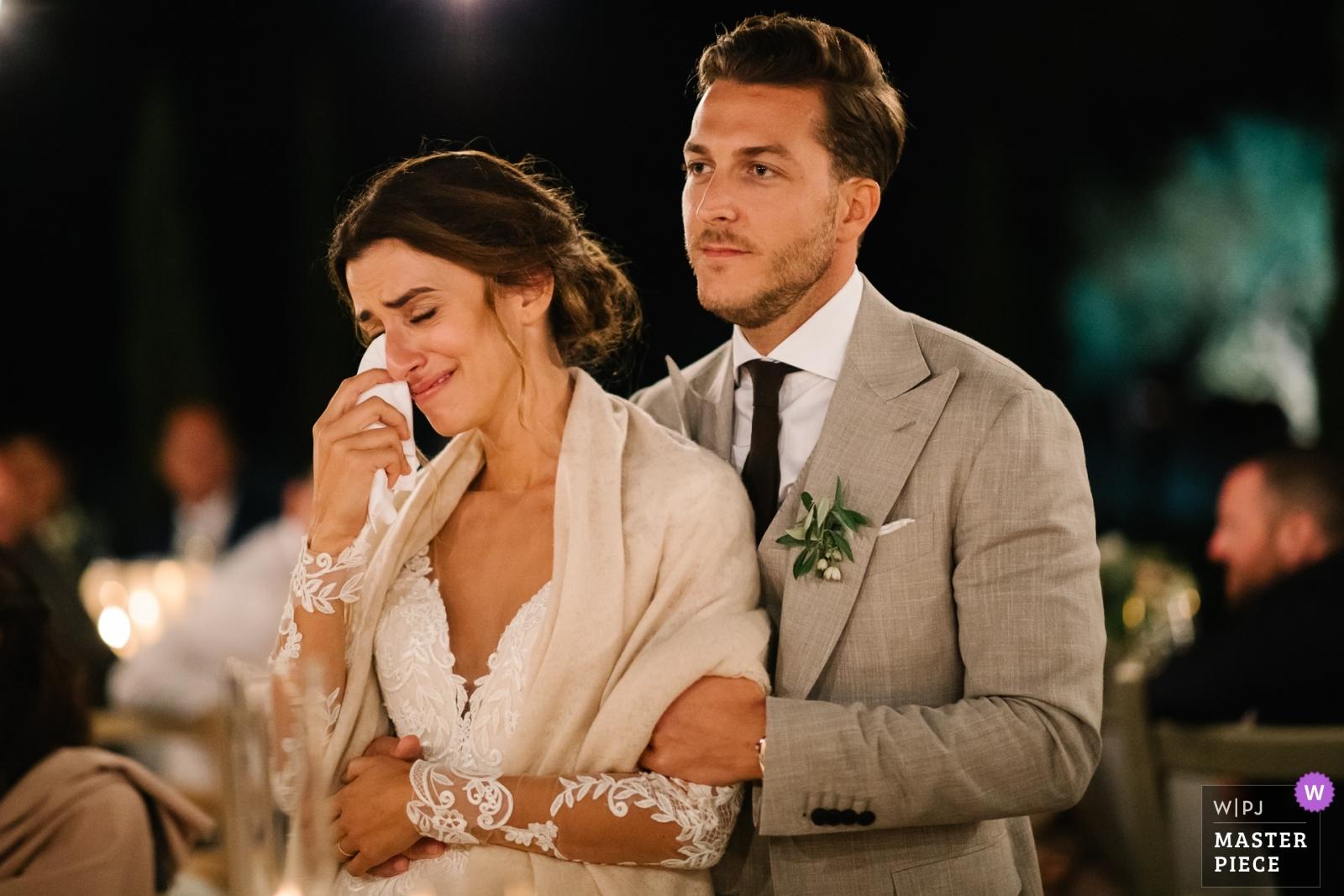 Bride crying tears, groom holding her - Portofino, Genoa Wedding Photography -  | Conti di San Bonifacio Wine Resort, Tuscany
