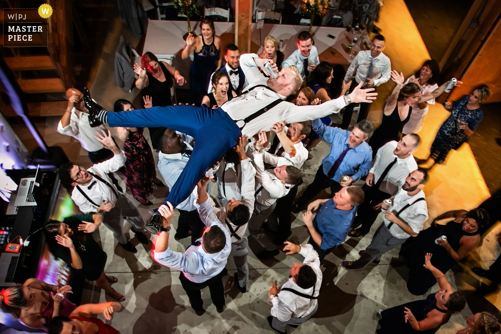 Groom is lifted into the air during reception and he decides to drink his beer - New Jersey, United States Wedding Photography -  | New Jersey