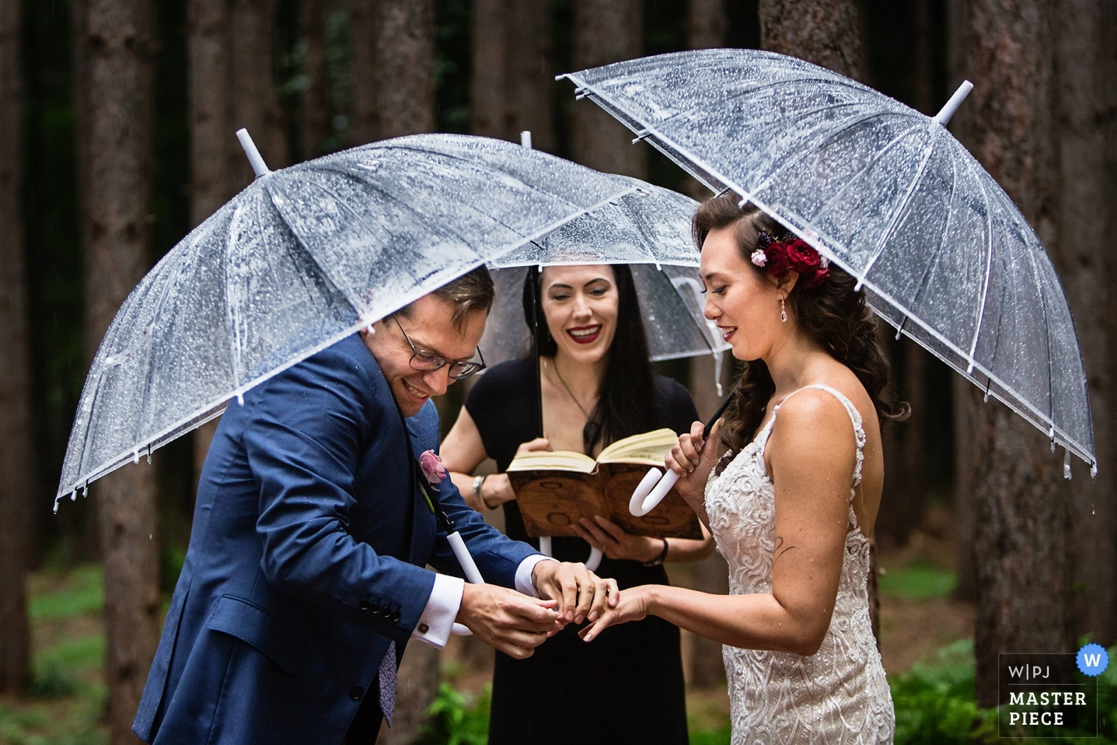 Groom struggles to put ring on bride's hand in the rain - New Jersey, United States Wedding Photography -  | Roxbury Barn, Roxbury NY