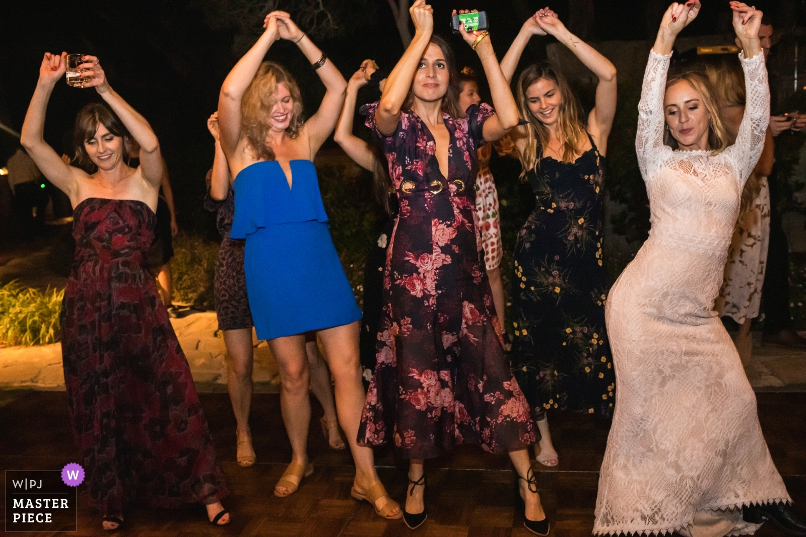 The bride and her friends dance on the dance floor. - Los Angeles, California - Southern Wedding Photography -  | Adamson House, Malibu, California