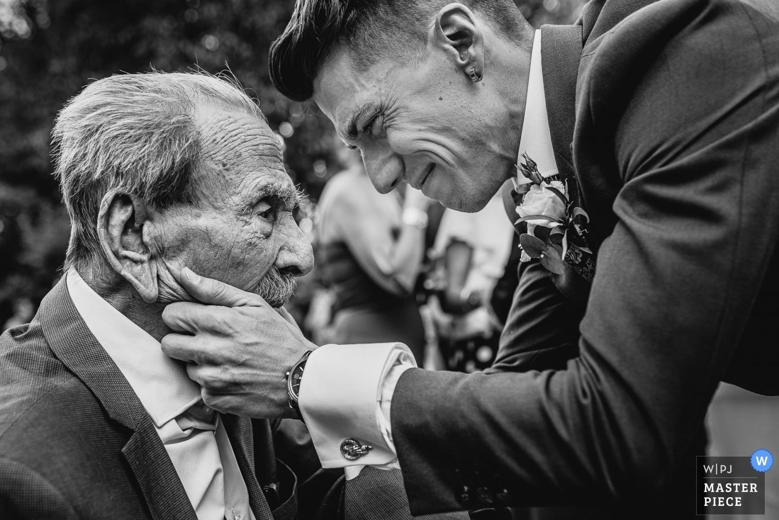 Groom greets his grandfather - Madrid, Spain Wedding Photography -    La Finca de Villanueva