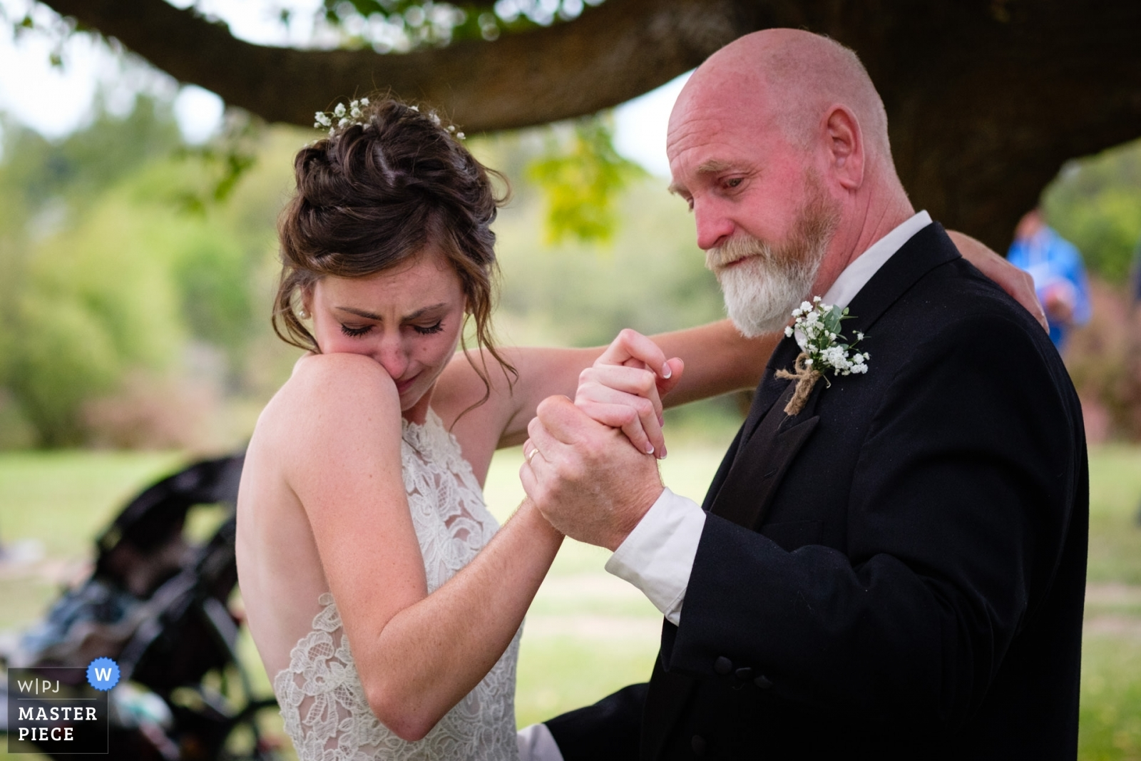 A bride tears up at the start of her father/daughter wedding dance. - Montana, United States Wedding Photography -    Brides family farm near Kalispell Montana