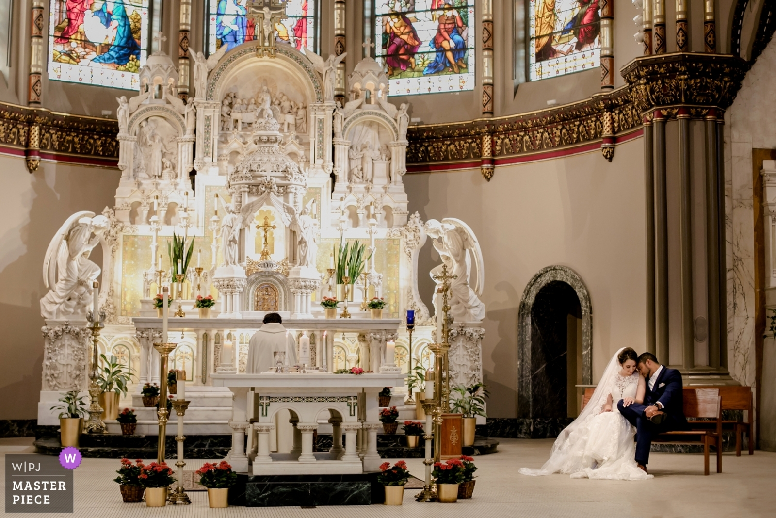 Bride and groom in the church - Chicago, Illinois Wedding Photography -  | St. Vincent de Paul church, Chicago