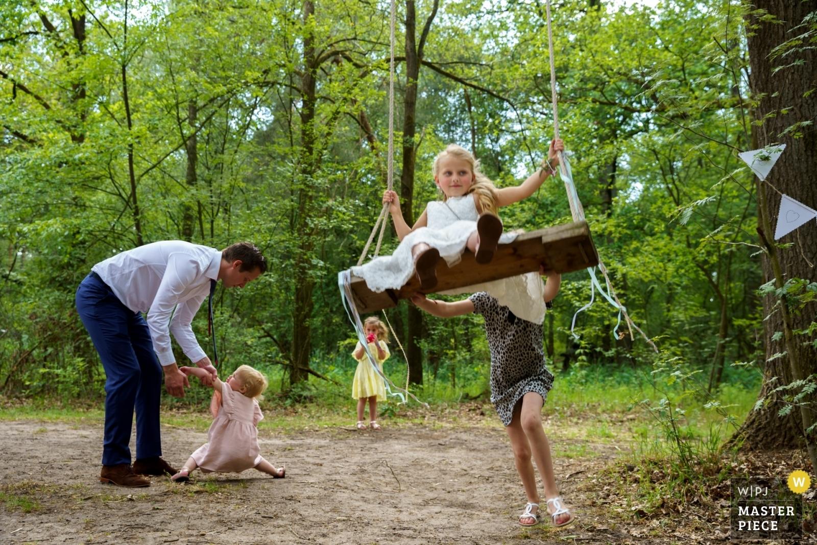 watch out for the swing! - Overijssel, Netherlands Wedding Photography -    De Lutte, Jan Wesselinkhoes