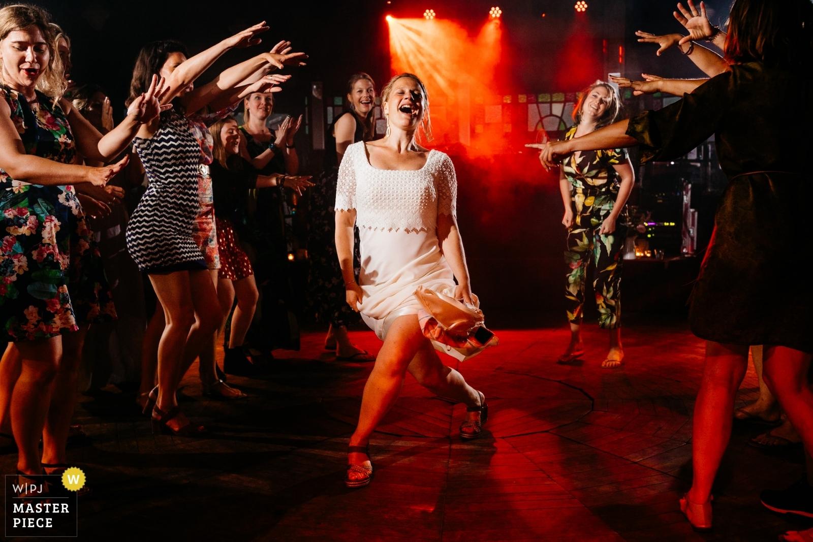 Bride dancing with her friends - Utrecht, Netherlands Wedding Photography -  | Party venue