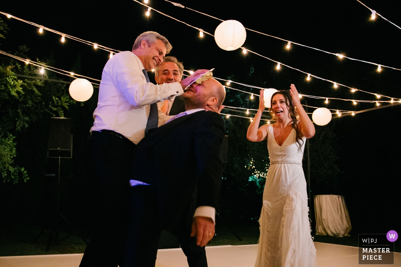 groom receiving cake in his face - Portofino, Genoa Wedding Photography -  | villa cimbrone ravello