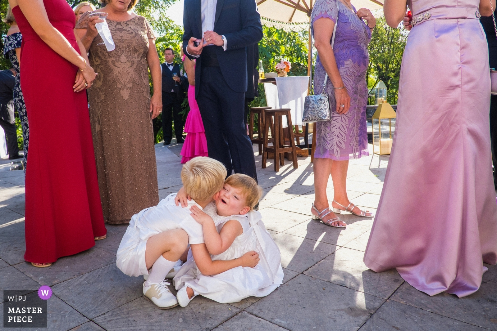 The flower girl and ring bearer flirt during the cocktail hour - San Diego, California - Southern Wedding Photography -  | San Miguel de Allende, Mexico, Casa Cien