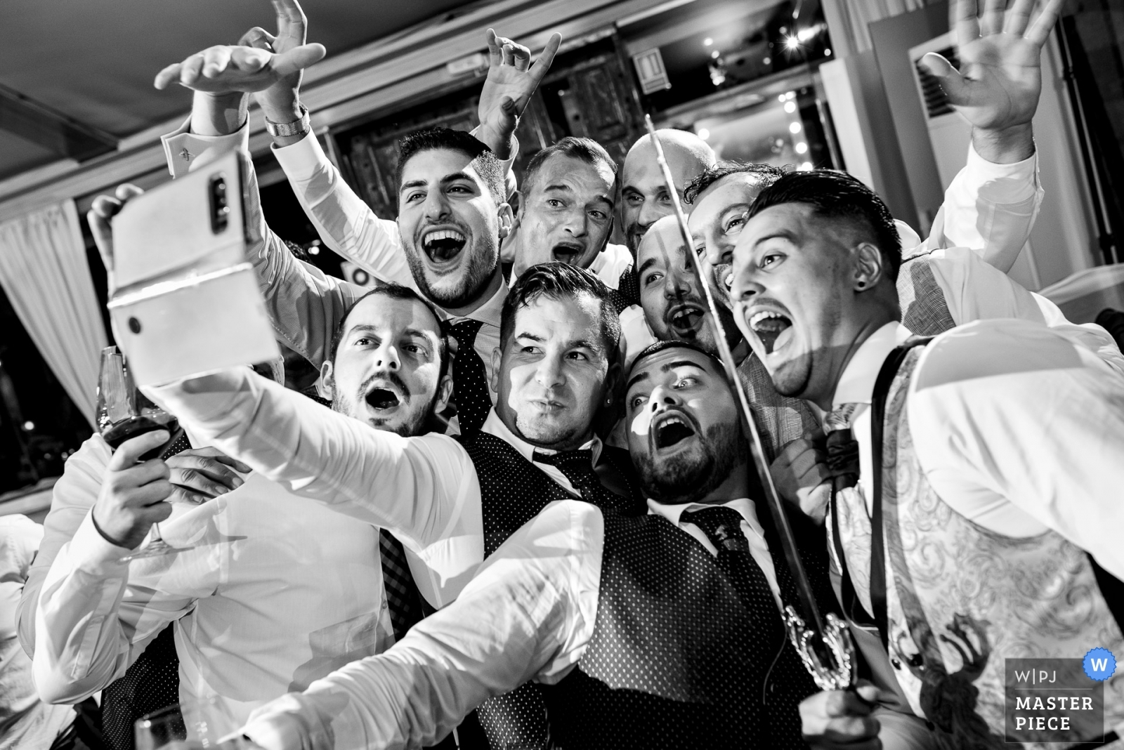 Groom and groomsmen take a selfie (with a sword) - Madrid, Spain Wedding Photography -    Mirador de Cuatro Vientos