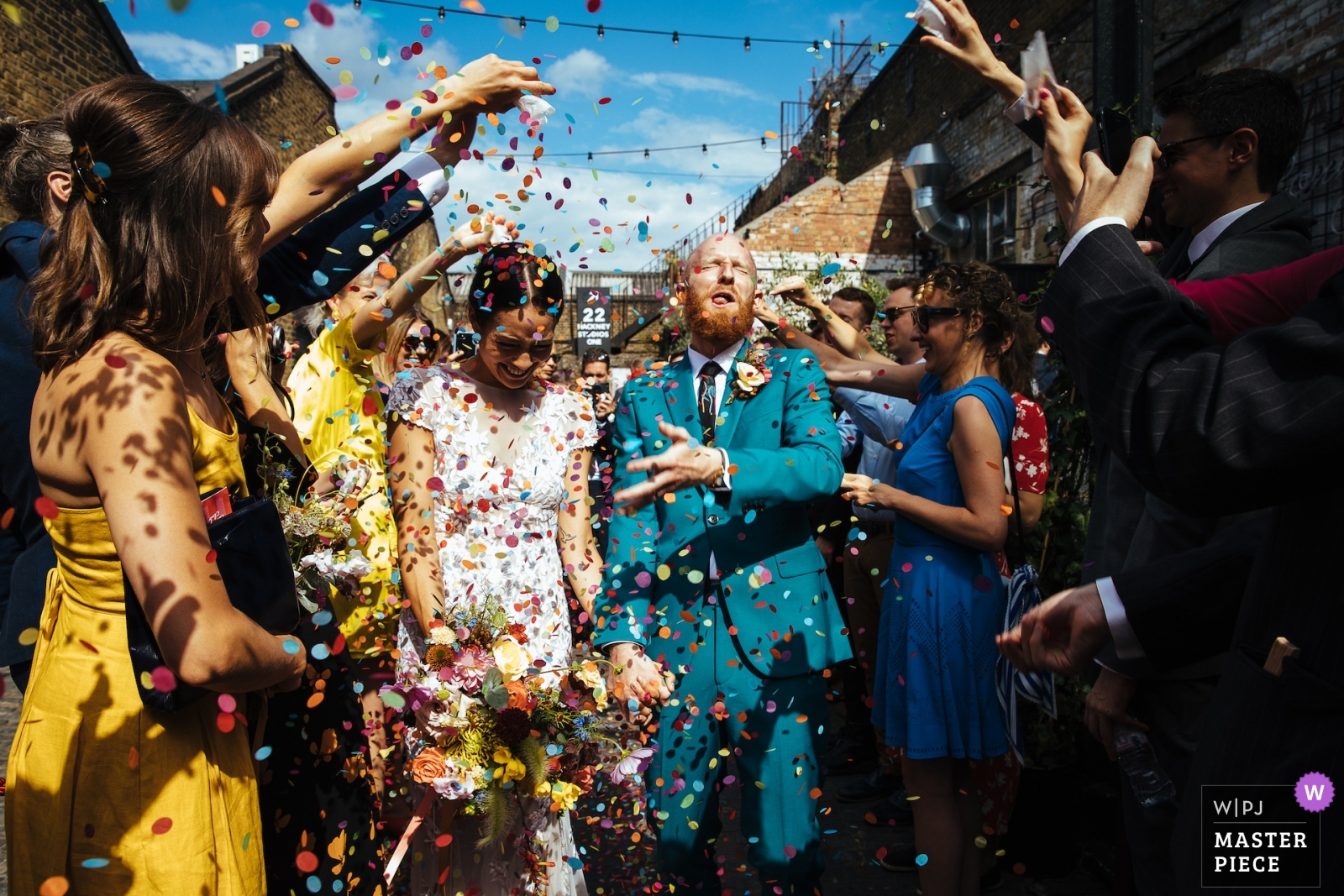 Groom gets a mouthful of confetti - London, England Wedding Photography -  | Ceremony and reception location