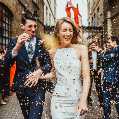 Confetti is thrown at a bride and groom - Derbyshire, East Midlands Wedding Photography -  | First Option Location Studios, Hackney, London