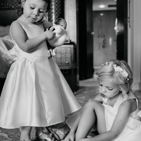 Chatty Flowergirls getting dressed  - Dubai UAE, United Arab Emirates Wedding Photography -  | The Ritz Dubai