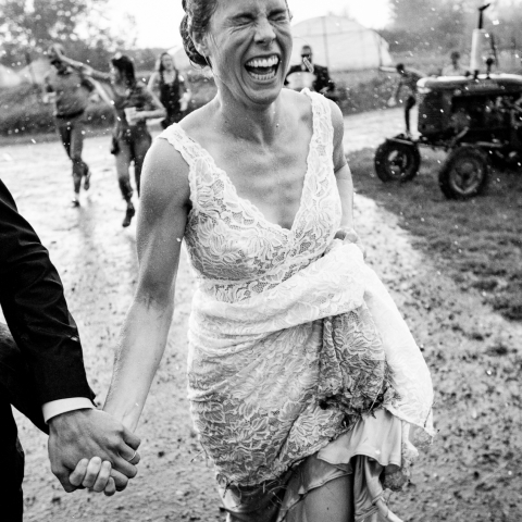 bride running in rain - Missoula, Montana Wedding Photography -  | Bozeman, Montana